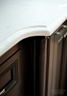 The Cambria countertop features a unique edge detail; the material was fabricated by CONSTRUCTION RESOURCES, INC.