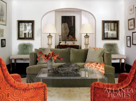 The homeowner's Oushak rug inspired the living room's sage green and orange scheme. The Venetian lamps are from Parc Monceau. The abstract painting above the chest is by an unknown artist.