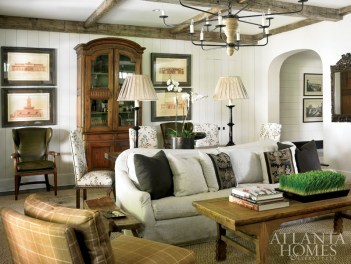 An understated scheme adds to the comfort level in the family room. For additional seating in the space, Burgess added crewel-covered chairs around the sofa table. The leather armchairs, by Minton-Spidell, are available through Paul + Raulet. Lamps, Holland & Company. Cocktail table, South of Market.