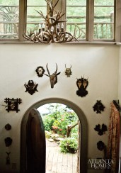 A collection of antlers–antique and quirky, real and resin–are hung throughout the house, but are concentrated in the foyer.