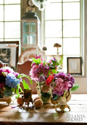 Fresh flowers add a pop of color to the dining room.