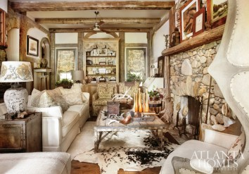 Architect Michael Faust designed the asymmetrical mantel and stonework surrounding the fireplace and passageway to mimic a riverbed with driftwood woven throughout the rock, including the sculptural roots, which add visual support to the base of the fireplace. Cozy and comfortable seating was given priority in the living room.