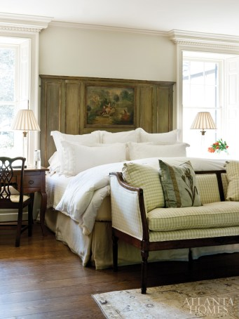 Connor transformed a French trumeau mirror into a headboard by adding side panels. Windows—painstakingly rebuilt to imitate the originals, with shutters that fold neatly into pockets in the window jambs—were left unadorned, as the shutters provide for privacy.