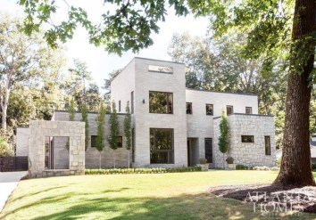 """""""Imagine that Corbusier had come over in the 1930s, found this piece of property and built a modern structure and just left it there. That's the feel that we were going for; not necessarily contemporary but more of a modern house,"""" says architect Rodolfo Castro about this two-story treasure. A combination of Georgia granite and oversized concrete bricks adds interest to the exterior layers."""