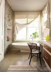 In the master bath, an Italian Agape tub focuses squarely on a see-through fireplace, which can also be enjoyed in the adjacent bedroom, that's surrounded by pebble stone on both sides.