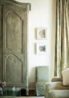 A large 1780 Bordeaux armoire from Jacqueline Adams Antiques anchors the living room. The silk drapery fabric by Nobilis adds a layer of subtle color, and slipper chairs—covered in an Etamine fabric—offer easy-to-move seating.