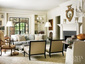It's all about the mix in this Garden Hills cottage, where traditional pieces from the owners—previous home of 29 years mingle with newer, contemporary ones, such as Nancy Corzine slipper chairs in tufted Jerry Pair Leather. The antique needlepoint chair, acrylic coffee table and mid-century lamps are all from Travis & Company, while the antique hassock is from William Word Antiques. The sumptuous William Yeoward sofa is from Grizzel & Mann, and the silk-and-wool rug is Eve & Staron.