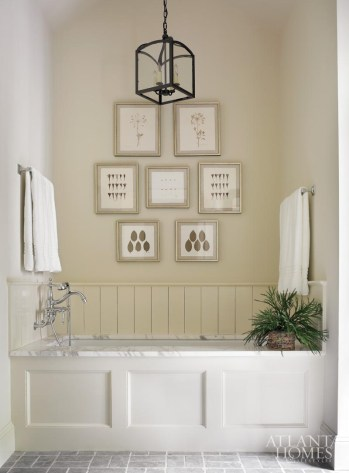 In the master bath, framed botanicals from the Atlanta History Center form a charming focal point.