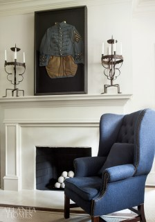 A University of the South uniform from Prillaman's great grandfather—one of three Prillaman found in her grandmother's attic—takes pride of place above the mantel, and was the starting point for Ferrier's color palette. The pair of candlesticks were a souvenir from a buying trip that Prillaman took with Ferrier and architect Bobby McAlpine to Belgium.