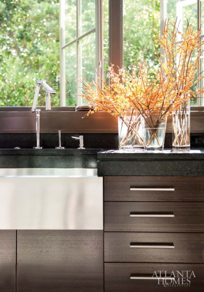 "To accommodate Kevin's height, kitchen counters are 39 inches tall, though the sink is dropped to standard height. The faucet is by Kohler. ""When you have a height difference of over a foot between the husband and wife, you have to figure out a way to allow them both to use the same kitchen,"" says Kelly."
