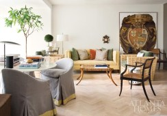 """Architect and homeowner Bill Ingram admits he has a preference for """"leggy chairs and furniture that are lifted off the floor,"""" like the sofa from Lee Stanton Antiques, black Regency chairs from Parc Monceau and Saber Leg ottoman by Formations. Still, he adds, it's important that not everything be up on """"tiptoes."""" In this living area, a pair of rope lounge chairs with mohair cushions establishes a masterful mix. The 17th-century Italian fresco is from Jeff Littrell Antiques."""