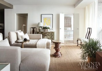 Proving that treasured antiques can mix with contemporary art and pieces less precious, a painted French chest and print by artist Sean Greene are right at home with down-filled chaises from West Elm.