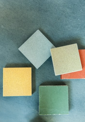 Five color samples offer a hint of the range of colors in which concrete and terrazzo fixtures and furnishings by Dex Industries are available.