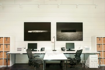 Two eye-catching, black-and-white photographs by Todd Murphy take center stage on a wall in the design studio.