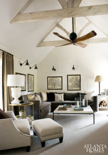 Subtle tones and texture create a casual but refined family room. A set of tree engravings from Foxglove Antiques, highlighted by Boston Functional lights from Circa inspired the room's design. The Alabaster lamp is from Circa; the custom mohair sectional is by ADMI. The coffee table, topped by hurricanes by Formations through Jerry Pair, is by Bradley; the linen chair and ottoman and the Jonathan round side table are from from Bungalow. The polished wood Aliseo ceiling fan is by Aria Vent through Grizzel & Mann.