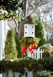 Festooned with evergreen trimmings, Ervin's Haynes Manor home, including a handcrafted birdhouse, exudes holiday curb appeal at every turn.