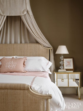 Weaks dressed the canopied master bed by Edward Ferrell + Lewis Mittman in plush neutrals with a dash of pink, lending a romantic contrast. The bed drapery is by Coraggio, and the linens are from Gramercy; the mirrored bedside tables were found at Panache Designs; the lamps are from Parc Monceau.