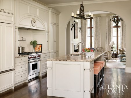 Floor-to-ceiling cabinetry gives the illusion of space in the eat-in kitchen, open to the dining and living rooms. Custom TecnoSedia bar stools, C. Weaks Interiors.