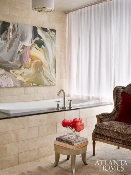 Peace injected color into the master bath with furniture and fabric sourced from R. Hughes. A painting from Alan Avery Art Company emits serenity from above.