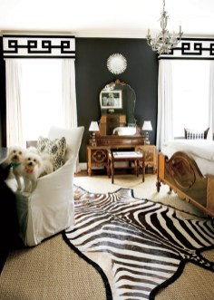 """The guest room doubles as a home office. The Art Deco wood inlay bedroom set was inherited from the designer""""s great grandmother. Draperies and valence fabricated by Barter and Galambos, (404) 364-9011. Curtain linen and trim, Lewis & Sheron Textile Co., (404) 351-4833. Chandelier, Lisa Thompson and Associates, (404) 262-2253. Mirror over vanity, Antiques and Beyond, (404) 872-4342. Chair, Lee Industries, (404) 688-1235. Pillow, Pieces, (404) 869-2476."""