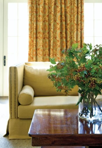A detail of the great room reveals Jane Shelton draperies in Bacchus Burnt Orange, Travis & Co., (404) 237-5079.
