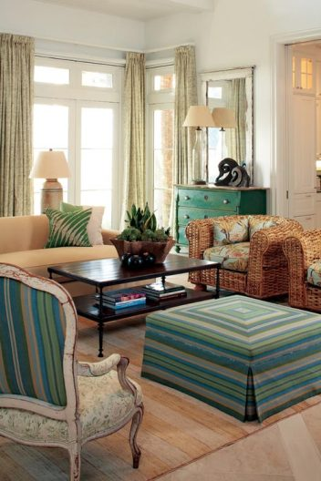 Designer Billy Roberts managed to keep the massive living room, with 30-foot ceilings, comfortable and intimate, choosing pieces such as the vintage Ralph Lauren barrel chairs for their scale.