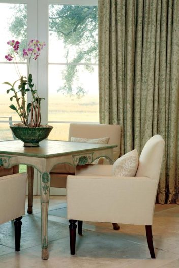 A sitting area in the living room overlooks the salt marshes and drooping oaks.