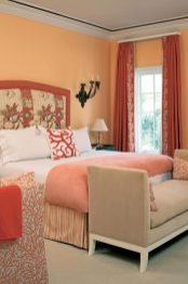 One of the warmest, most enveloping rooms in the house is the marsh-side guest suite; a study in corals, the walls pick up the colors of the sunset in the evenings.