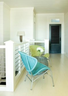 On the second-floor landing, a pair of practically indestructible chairs provides a place for children to hang out.
