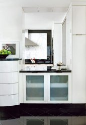 A classic black-and-white scheme dominates the kitchen, with its Black Absolute granite backsplash, countertops and flooring by Design Galleria.