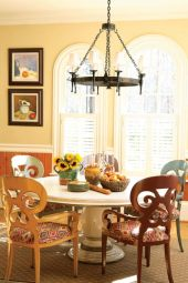 The light and airy breakfast room, which opens to the family room, is a delight of traditional lines and homey comforts.