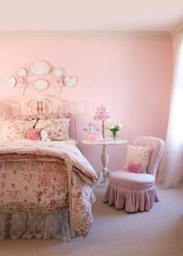 """The girl""""s room is awash in pinks, presenting a fresh, cottage glamour."""