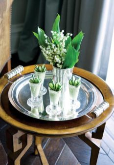Accented with Lily of the Valley in a silver julep cup, Howard served up a tray of avocado-cucumber soups in chilled vodka glasses.