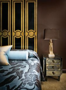 For the new master suite addition at the home he shares with Keith Traxler, Chad Holman used an elegant black and gold screen in place of a traditional headboard. Bedspread fabric, Jim Thompson. Mirrored nightstand, The Stalls.