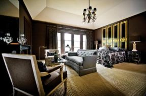 """The new master bedroom is glamorous and totally chic, but still honors the home""""s original 1940s architecture."""