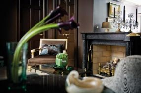"""The bedroom""""s black marble mantel from Jerry Pair is French Empire, c. 1810. Carpet, Myers Carpet."""
