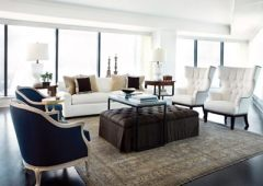 """Light spills into the living spaces of Barbara Westbrook""""s 42nd floor designer model, highlighting sumptuous textures like antique rugs, a cashmere upholstered ottoman, sleek wood floors and velvety custom pillows."""