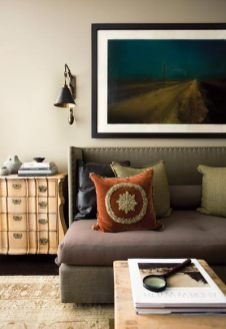 The study offers a rustic, more masculine vibe, with an antique Oushak rug, textural fabrics and lots of leather. Blond woods give it an easy, light-hearted verve.