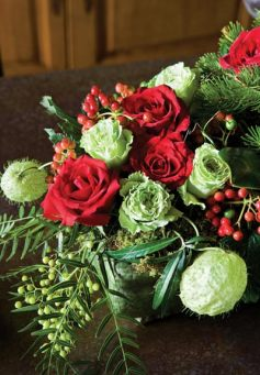 Mark & Scott put a spin on traditional red and green with a contemporary floral arrangement.