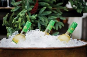 Even the wine bottles green foil tops seemingly get in the holiday spirit, echoing the color of the evergreen boughs just beyond.