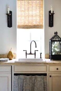 """Even in this diminutive structure there was enough space to carve out a small kitchen, adding a level of convenience for entertaining""""and cleanup afterward."""