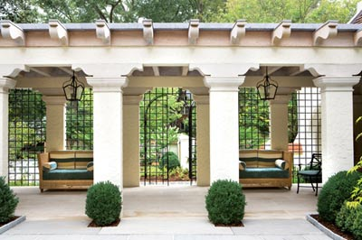 """With furnishings limited to a select few""""like this pair of settees""""the loggia is just as understatedly elegant as the landscape architecture, compliments of Richard Anderson."""