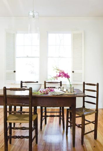 A primitive farm table is one of the family's favorite gathering spots. Elizabeth acquired it from her parents, who purchased it in Athens when her father was studying law at the University of Georgia. The nearby shutters, also culled from her father's house, let in much more light than draperies would have.
