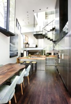 This vantage point in the kitchen offers one of the best interior views of the new addition. It's designed as a series of split-levels, each spiraling around a new central staircase. The stairs, with no visible stringers, culminate at a roof deck with a breathtaking view.