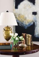 A traditional table is juxtaposed with contemporary artwork, the diversity increasing the impact of each.