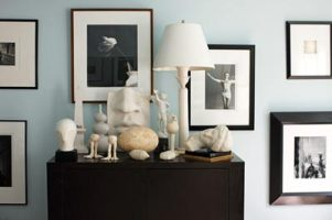 A wall of black-and-white photography and an enchanting tableau includes a photograph of Sting by Victor Skrebneski, as well as pieces by Tom Fleming, Tom Otterness and Jonathan Adler. The white ceramic head is from Ricco/Maresca in New York, and the 19th-century marble bust is from Spalding Nix. The lamp is a Jean Michel Frank piece, which Oetgen bought in Paris more than 20 years ago.