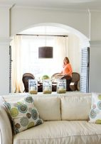Designer Liz Williams thought a pair of shutters would make the columns between the living and dining rooms seem less formal. As luck would have it, homeowner Carol Moore stumbled upon the perfect pair at a flea market—not only the right size, but even the ideal shade of soothing blue.