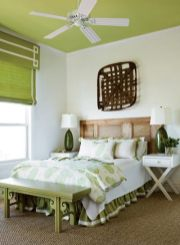 Lime green and crisp white team up in this retreat to create a refreshing feeling—from the bedding to the window treatment and right on up to the ceiling.