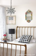 """""""The guest room is just a funky mix of stuff,"""" the designer explains. """"I used a little Hinson print and a fun bed—a big sleigh bed in iron."""" As a result, the room doesn't really go feminine or masculine, making it perfectly appropriate for all visitors."""