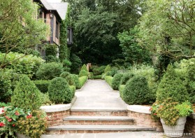 A view of the home's exterior reveals the charms of this home's landscape design.